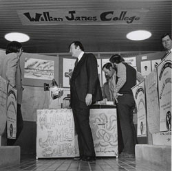 President Arend D. Lubbers in front of a William James College display.